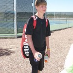 04/11/2008 - Alex at high school tennis regionals.